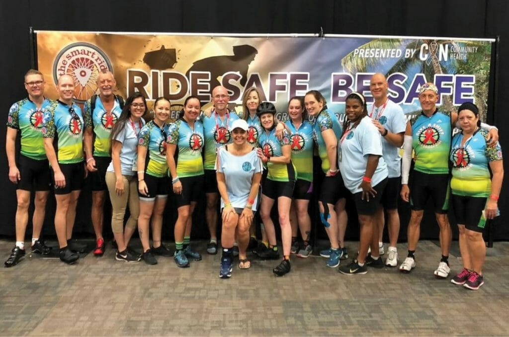 Broward House staff and team of Give A Shift pose before the 1st morning ride of 100 miles.