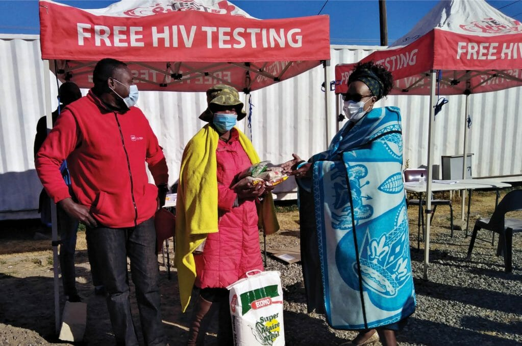 AHF_Clients receive food parcels at an AHF Lesotho food distribution event