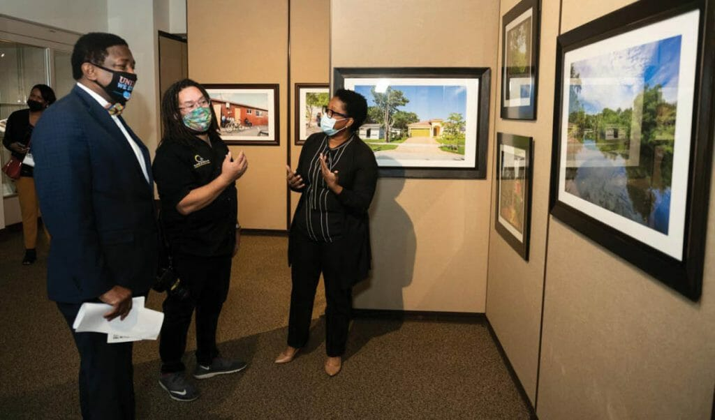 Sistrunk_Broward County Commissioner Dale Holness with artist David I. Muir and exhibition curator Dominique Denis