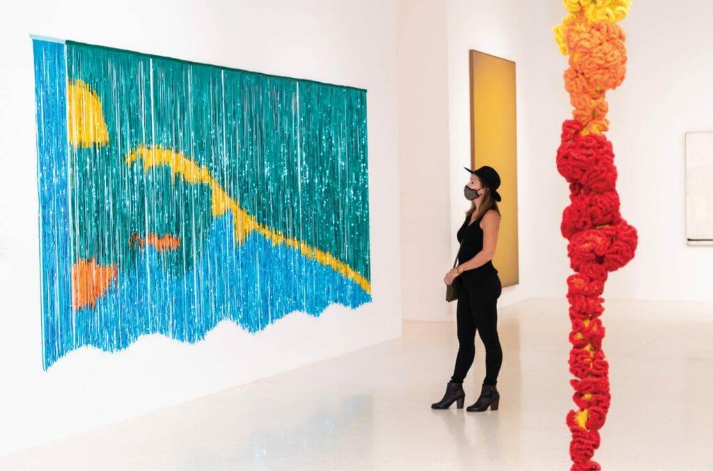 Woman looking at artwork