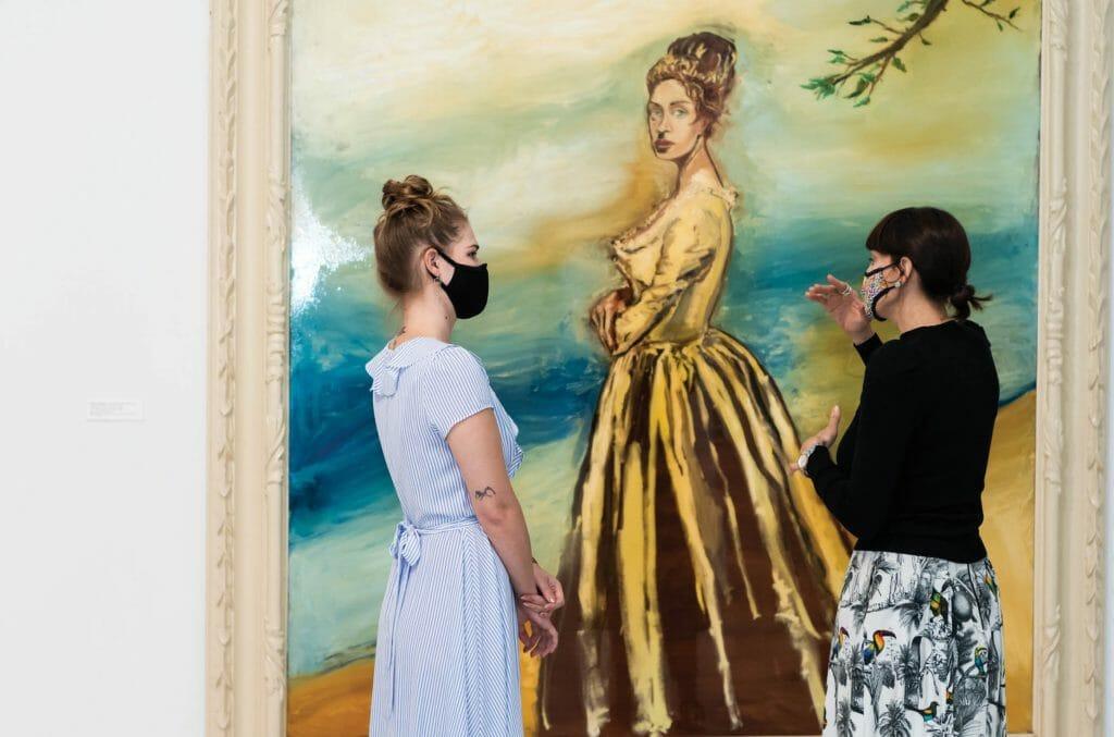 Women Looking at art work