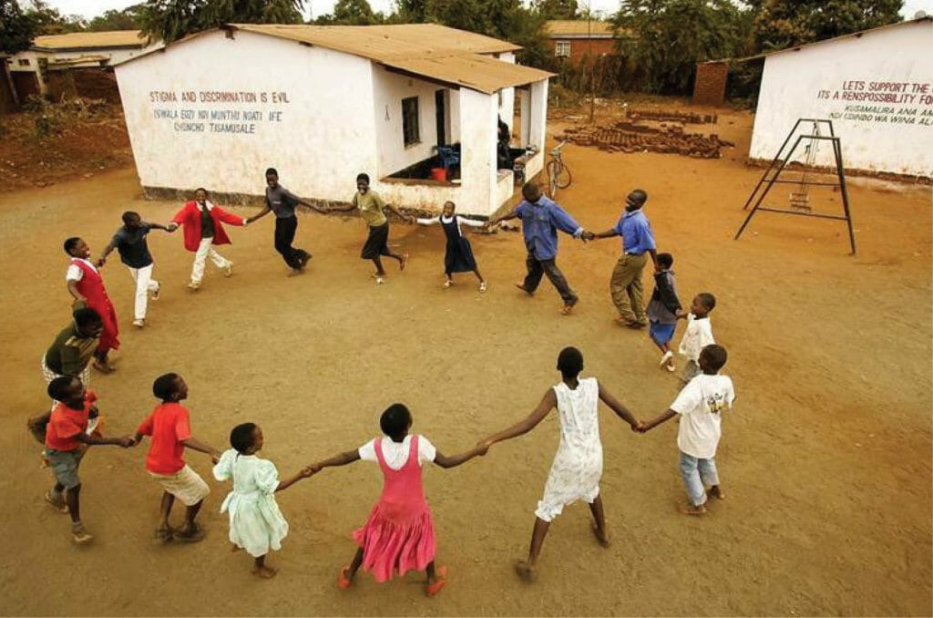 2005 | Lilongwe, Malawi. Orphans sing and dance at Kanego AIDS Support Organization, one of many groups caring for the country's AIDS orphans.