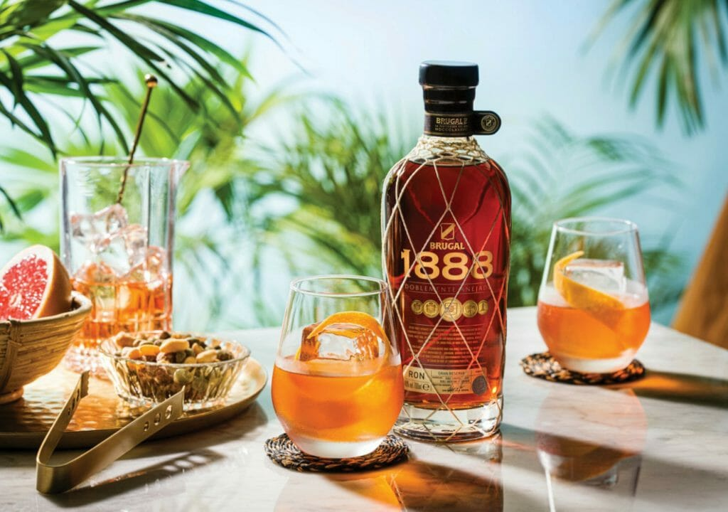 1888 Rum on a table with clasess