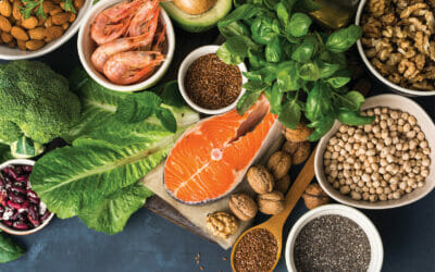 Food sources of omega 3 on dark background with copy space top view. Foods high in fatty acids including vegetables, seafood, nut and seeds. Health food fitness