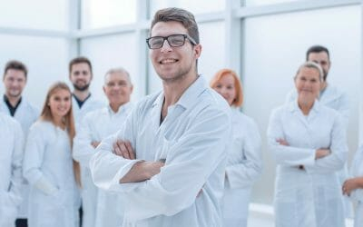group of confident medical professionals standing together.
