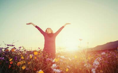 lifestyle concept - beautiful happy woman enjoying fresh air in cosmos flower field